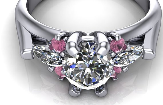 Custom pink tourmaline accented engagement ring with flyaway marquise diamond sides. Top view.