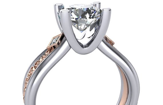 Custom engagement ring with rose gold detail inlayed in shank with styled u-prongs