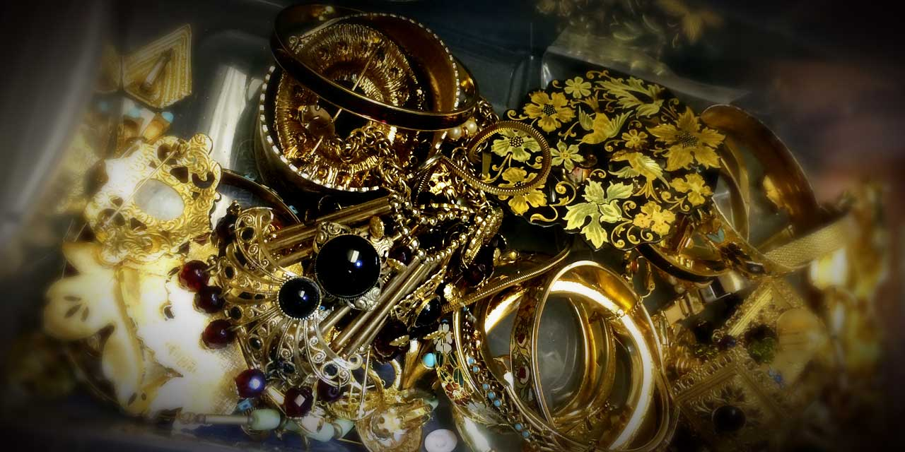 An assortment of miscellaneous jewelry ready to be sorted.